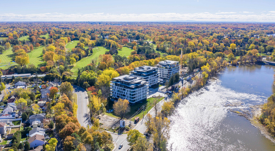 L | L sur le Lac Surrounded by Fall's beauty - Aerial view October 2019